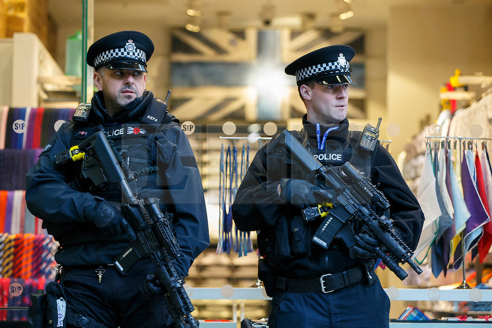 © Licensed to London News Pictures. 22/03/2016. London, UK. Armed police patrolling at London St Pancras Eurostar station as all Eurostar trains to Brussels have been cancelled the following the Brussels terror attacks on Tuesday, 22 March 2016. Photo credit: Tolga Akmen/LNP