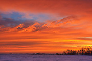 Sunrise over the prairie in winter<br /> Deacon's Corner<br /> Manitoba<br /> Canada