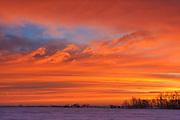Sunrise over the prairie in winter<br /> Deacon's Corner<br /> Manitoba<br /> Canada