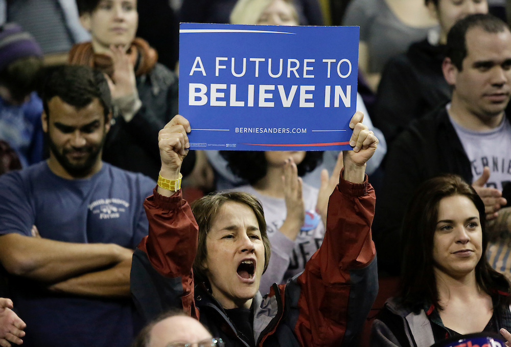 A woman cheers at a rally for Democratic presidential candidate Bernie Sanders at Key Arena on March 20, 2016 in Seattle.  AFP PHOTO/JASON REDMOND