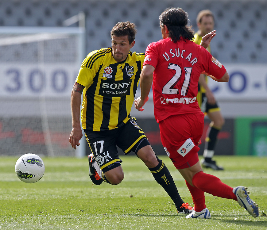 Wellington Phoenix's Vince Lia is challenged by Adelaide United's Francisco Usucar in the Hyundri football A-league match, Eden Park, Auckland, New Zealand, Saturday, November 19, 2011.  Credit:SNPA / David Rowland