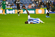 Juninho Bacuna of Huddersfield Town (7) down injured during the EFL Sky Bet Championship match between Huddersfield Town and Derby County at the John Smiths Stadium, Huddersfield, England on 5 August 2019.
