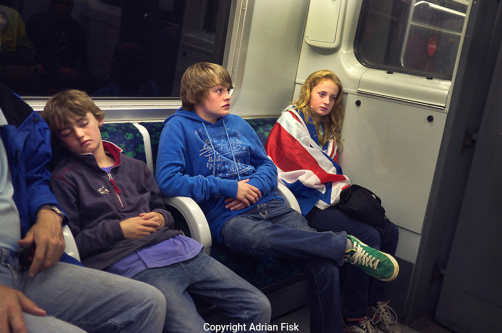 Team GB fans return home late on the tube