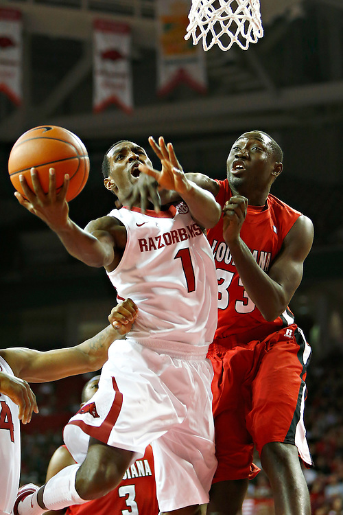 FAYETTEVILLE, AR - NOVEMBER 15:  Mardracus Wade #1 of the Arkansas Razorbacks goes up for a shot and is fouled by Vieux Kande #33 of the Louisiana Ragin' Cajuns at Bud Walton Arena on November 15, 2013 in Fayetteville, Arkansas.  (Photo by Wesley Hitt/Getty Images) *** Local Caption *** Mardracus Wade; Vieux Kande
