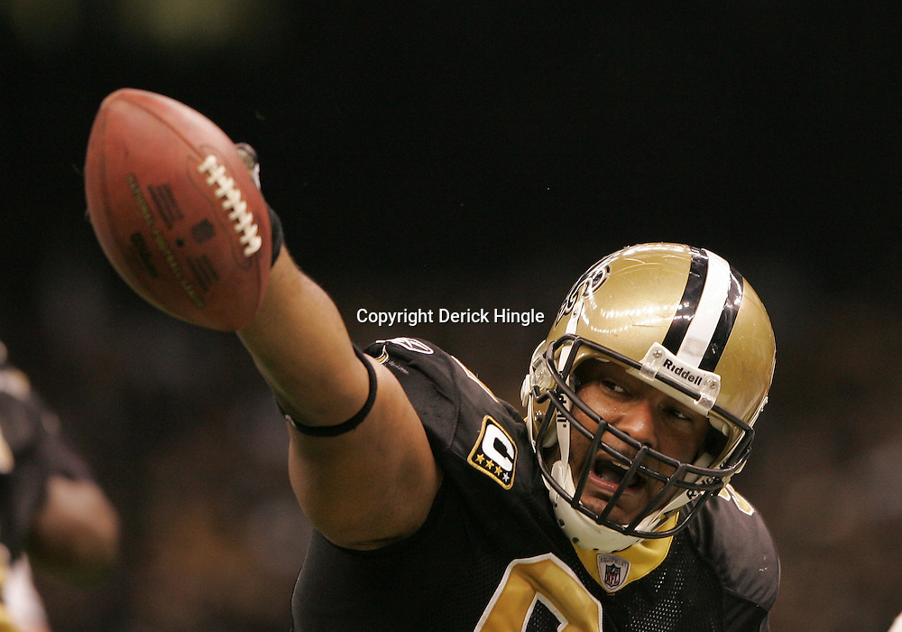16 January 2010:  New Orleans Saints defensive end Will Smith (91) celebrates after an interception during a 45-14 win by the New Orleans Saints over the Arizona Cardinals in a 2010 NFC Divisional Playoff game at the Louisiana Superdome in New Orleans, Louisiana.