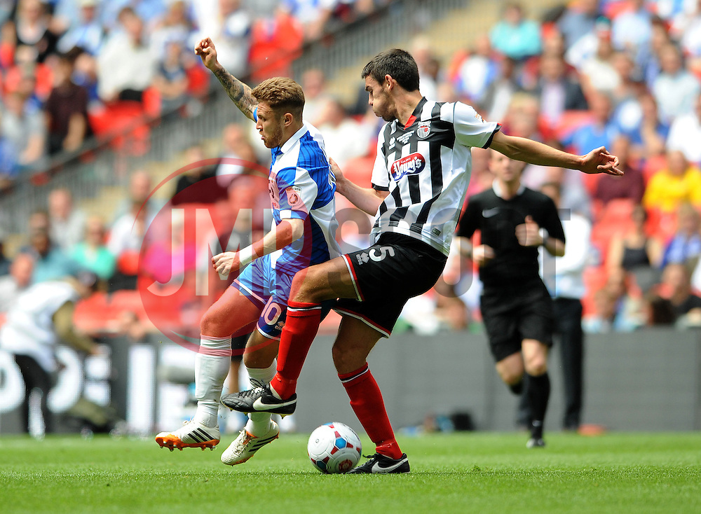 Bristol Rovers' Matt Taylor is tackled by Grimsby's Shaun Pearson - Photo mandatory by-line: Dougie Allward/JMP - Mobile: 07966 386802 - 17/05/2015 - SPORT - football - London - Wembley Stadium - Bristol Rovers v Grimsby Town - Vanarama Conference Football