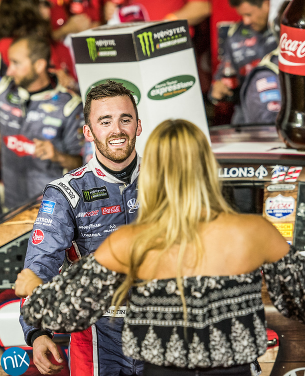 Austin Dillon celebrates winning the Coca-Cola 600 at Charlotte Motor Speedway Sunday, May 28, 2017.
