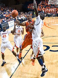 Clemson guard Demontez Stitt (2) shoots over Virginia center Assane Sene (5).  The Virginia Cavaliers defeated the #12 ranked Clemson Tigers in overtime 85-81 at the John Paul Jones Arena on the Grounds of the University of Virginia in Charlottesville, VA on February 15, 2009.