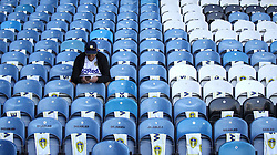 A Leeds United fan in the stands before kick-off