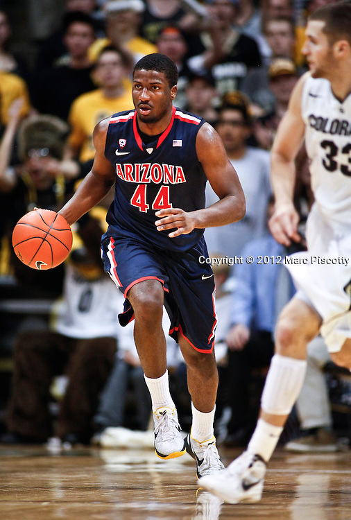 SHOT 1/21/12 5:32:25 PM - Arizona's Solomon Hill #44 dribbles the ball upcourt during their PAC 12 regular season men's basketball game against Colorado at the Coors Events Center in Boulder, Co. Colorado won the game 64-63..(Photo by Marc Piscotty / © 2012)