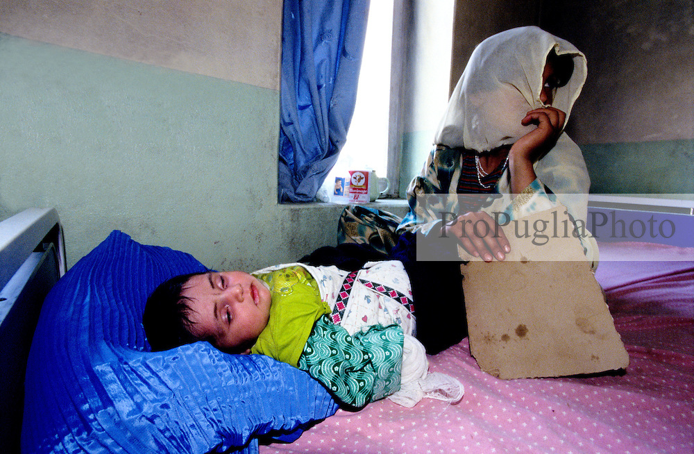FAIZABAD PROVINCIAL HOSPITALl, 27 July 2005..A mother use the burqa for her child pillow's case....According to United Nations Population Fund, Afghanistan has among the world?s highest rates of maternal mortality, and Badakhshan has the highest rates ever recorded anywhere in the world, with one mother dying in every 15 births. ....