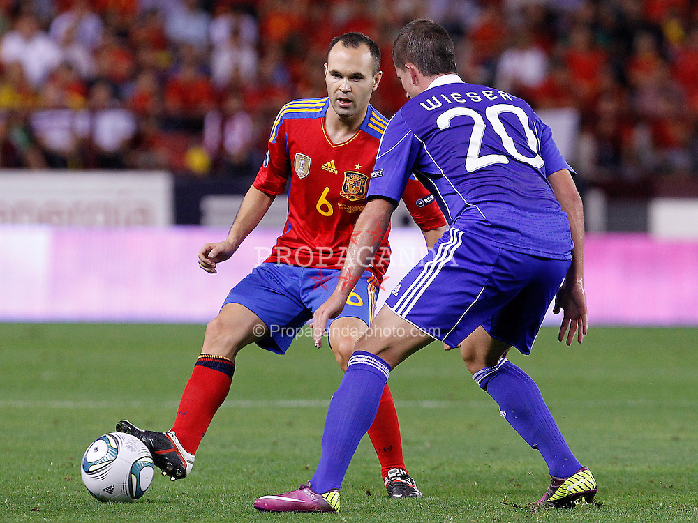 06.09.2011, Logrono, ESP, UEFA EURO 2012, Qualifikation, Spanien vs Lichtenstein, im Bild Spain's Andres Iniesta (l) and Liechtenstein's Sandro Wieser during Euro 2012 qualifier match.September 6,2011.. EXPA Pictures © 2011, PhotoCredit: EXPA/ Alterphoto/ Acero +++++ ATTENTION - OUT OF SPAIN/(ESP) +++++