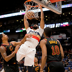 Jan 9, 2019; New Orleans, LA, USA;  New Orleans Pelicans forward Anthony Davis (23) dunks over Cleveland Cavaliers guard Jordan Clarkson (8) and guard Alec Burks (10) during the first quarter at the Smoothie King Center. Mandatory Credit: Derick E. Hingle-USA TODAY Sports