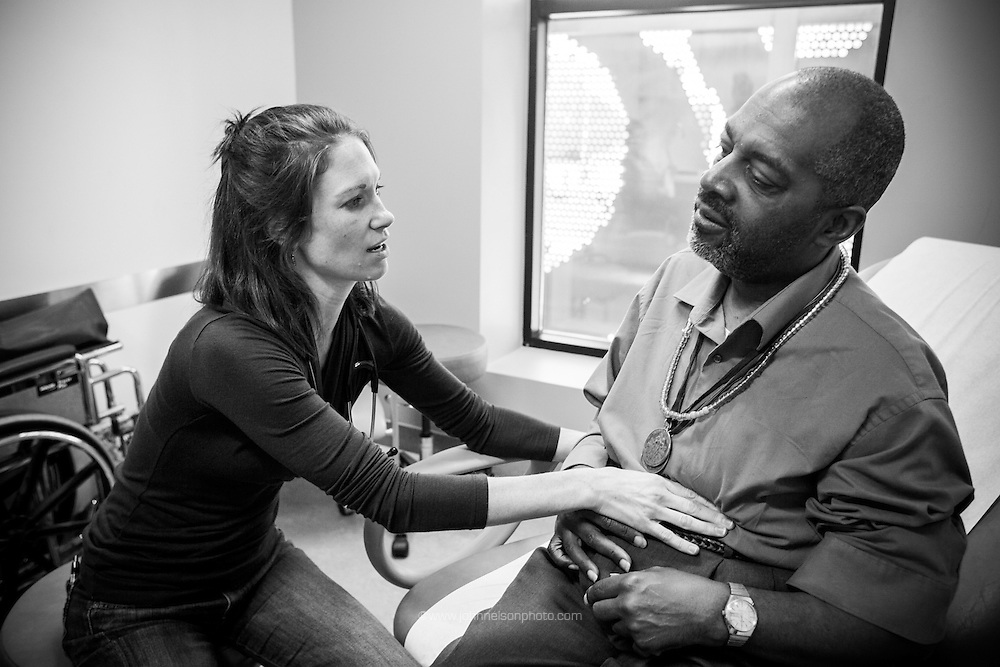 "Physician assistant Jen Vaupel examines Robert ""Bobby"" Young's during a check up at Bread for the City in Washington, DC."