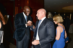Left to right, OZWALD BOATENG and JOHAN ELIASCH at a dinner hosted by Liberatum to honour Francis Ford Coppola held at the Bulgari Hotel & Residences, 171 Knightsbridge, London on 17th November 2014.