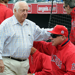 Former Los Angeles Dodgers manager Tommy Lasorda greets Los Angeles Angels manager Mike Scioscia before a spring training game at Tempe Diablo Stadium as the Angels beat the Dodgers in a split squad 4-1 on Saturday, February 26, 2011, in Tempe. Arizona. (SGVN/Staff Photo by Keith Birmingham/SPORTS)