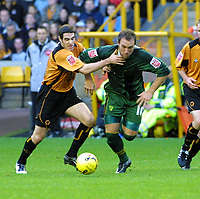 Photo: Dave Linney.<br />Wolverhampton Wanderers v Norwich City. Coca Cola Championship. 05/11/2005. Dean Ashton(Norwich) escapes the clutches of Mark Kennedy(Wolves)