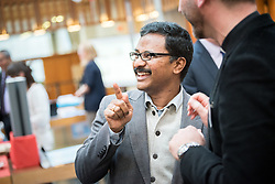 "18 September 2017, Geneva, Switzerland: A ""marketplace"" at the Ecumenical Centre in Geneva presents resources and activities of the World Council of Churches, at it hosts a meeting of member churches' Ecumenical Officers. Here, Dinesh Suna."