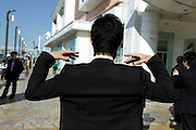 young businessman stretching while taking a short break outdoors Japan