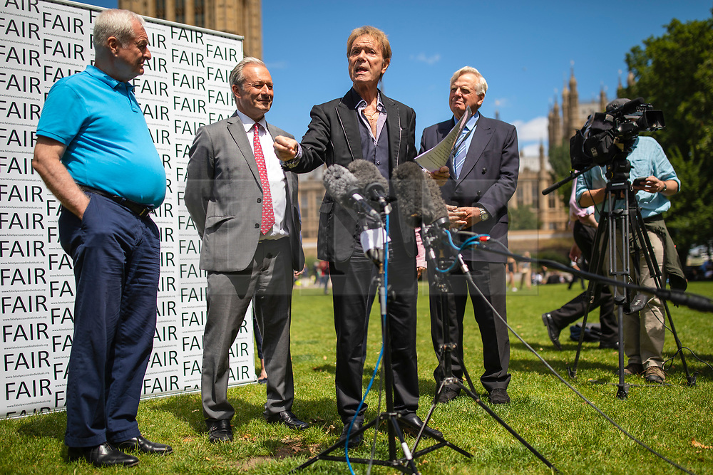 CAPTION CORRECTION © Licensed to London News Pictures. 01/07/2019. London, UK. Sir Cliff Richard (centre) joins Paul Gambaccini (L), Daniel Janner QC (2-L) and Lord Grade (2-R) at the launch of a campaign calling for a ban on naming sex crime suspects unless they have been charged. Photo credit: Rob Pinney/LNP