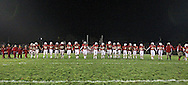 The Marion Indian senior cheerleaders and football team members walk the field after their second round playoff football game at Thomas Park Field in Marion on Monday, October 29, 2012.