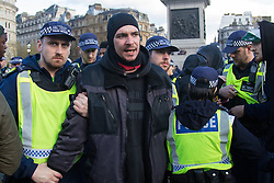"London, April 16th 2016. A man from a group of protesters dancing in Trafalgar Square is arrested on allegations of being in possession of cannabis after thousands of people supported by trade unions and other rights organisations demonstrated against the policies of the Tory government, including austerity and perceived favouring of ""the rich"" over ""the poor""."