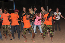 July 7, 2015 - BALULE RESERVE, SOUTH AFRICA: Black Mamba recuits enjoying a party during their spare time. LED BY BRITISH former military personnel these pictures show how courageous women anti-poachers train with guns in their battle to preserve Africa's endangered animals. Operating in the Kruger National Park's Balule Nature Reserve the 24-member strong all-female Black Mamba Anti-Poaching Unit patrols 50,000 hectares of bush to protect elephants and rhinos that are hunted as part of the estimated £12billion a year illegal world animal trade. These ladies, who as pictures show pose with weapons but also know how to party, are on the front line of a deadly war for the resources of their continent. Over the past year 1,000 wildlife rangers have been killed in Africa while protecting endangered wildlife. Black Mamba Commander and former Royal Navy serviceman Russell Baker (28) from Grimsby, UK explained exclusively how and why this South African special unit was established. (Credit Image: © Media Drum World/MediaDrumWorld/ZUMAPRESS.com)