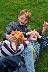 10 yr old boy playing with cousins in a park. Berkshire.