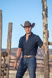 hot rugged cowboy on a ranch