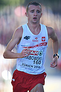 Marcin Chabowski from Poland competes in men's marathon during the Sixth Day of the European Athletics Championships Zurich 2014 at Letzigrund Stadium in Zurich, Switzerland.<br /> <br /> Switzerland, Zurich, August 17, 2014<br /> <br /> Picture also available in RAW (NEF) or TIFF format on special request.<br /> <br /> For editorial use only. Any commercial or promotional use requires permission.<br /> <br /> Photo by &copy; Adam Nurkiewicz / Mediasport