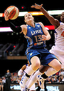 Sep 25, 2011; Phoenix, AZ, USA; Minnesota Lynx guard Lindsay Whalen (13) puts up a shot against the Phoenix Mercury forward Nakia Sanford (43)during the first half at the US Airways Center. Mandatory Credit: Jennifer Stewart-US PRESSWIRE