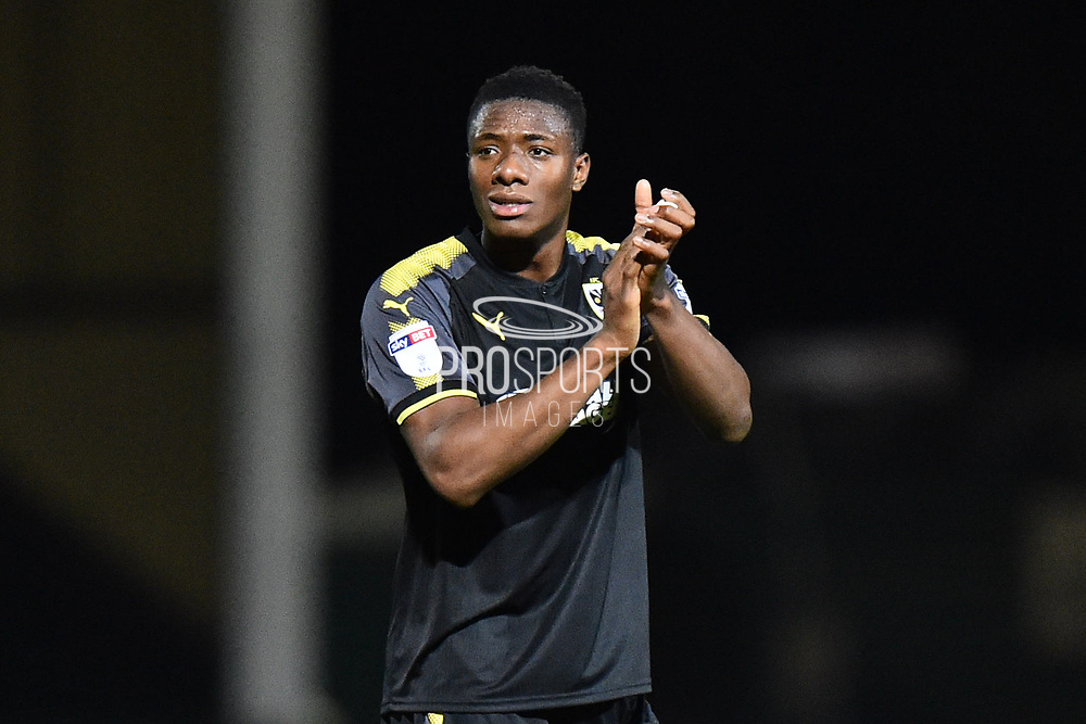 Paul Kalambayi (30) of AFC Wimbledon at full time applauds the travelling fans after a 2-0 loss to Yeovil during the EFL Trophy match between Yeovil Town and AFC Wimbledon at Huish Park, Yeovil, England on 5 December 2017. Photo by Graham Hunt.