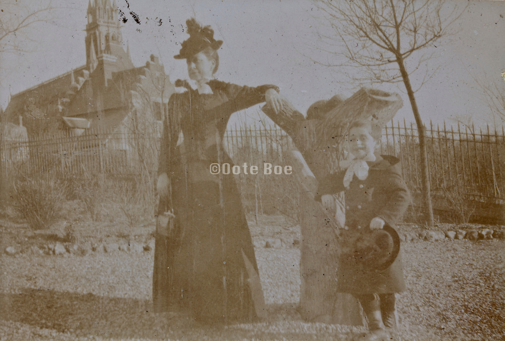 mother with child posing casually outdoors early 1900s France
