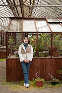 Debbie Warner of Sturdi-Built Greenhouse Manufacturing poses in the company's showroom in Portland, Ore.