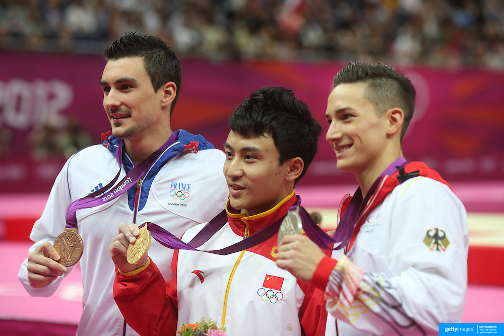 Medal winers in the Men's Parallel Bars Final, Hamilton Sabot, France, Bronze, (left), Zhe Feng, China, Gold, (centre) and  Marcel Nguyen, Germany, Silver, (right) at North Greenwich Arena during the London 2012 Olympic games London, UK. 25th July 2012. Photo Tim Clayton