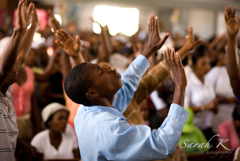 A congregation of 5,000 worships God in Port-au-Prince, Haiti. For many Haitians, church is a moment of heaven in the middle of their poverty-stricken world.