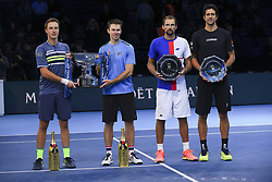 November 19, 2017 - London, England, United Kingdom - Winners, Henri Kontinen of Finland and John Peers of Australia and runners up, Marcelo Melo of Brazil and Lukasz Kubot of Poland hold their trophies following the doubles final during day eight of the 2017 Nitto ATP World Tour Finals at O2 Arena on November 19, 2017 in London, England. (Credit Image: © Alberto Pezzali/NurPhoto via ZUMA Press)