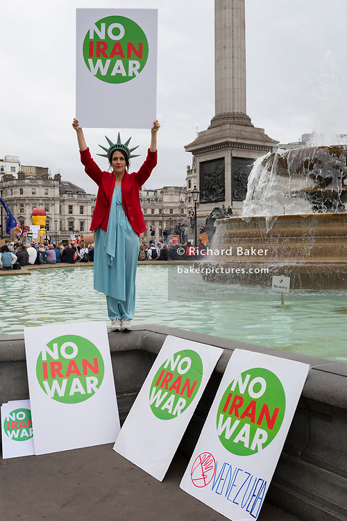 On US President Donald Trump's second day of a controversial three-day state visit to the UK, protesters voice their opposition to the 45th American President, in Trafalgar Square, on 4th June 2019, in London England.