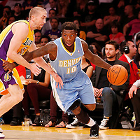 06 October 2013: Denver Nuggets point guard Nate Robinson (10) drives past Los Angeles Lakers point guard Steve Blake (5) during the Denver Nuggets 97-88 victory over the Los Angeles Lakers at the Staples Center, Los Angeles, California, USA.