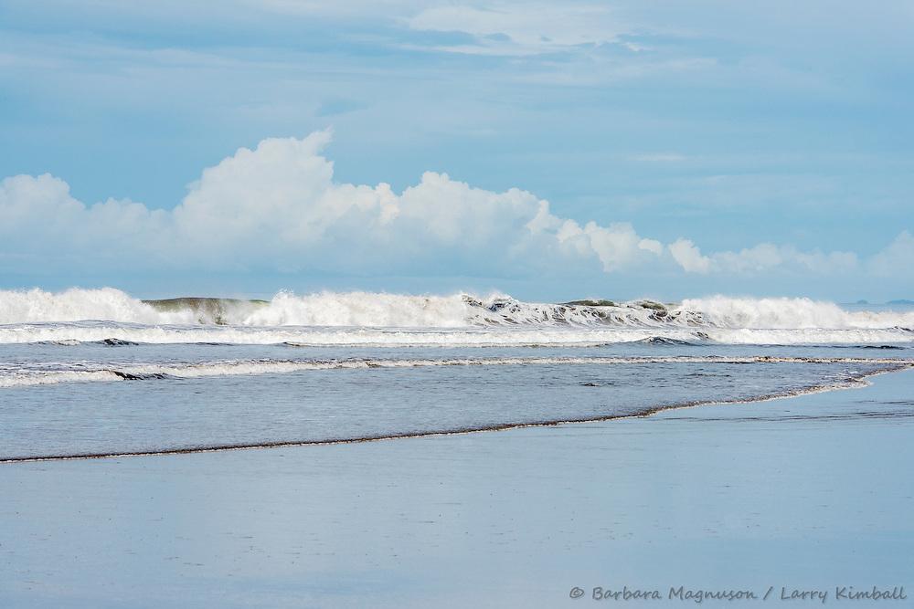 Ocean surf at low tide along Pacific Coast; Playa Las Lajas, Panama