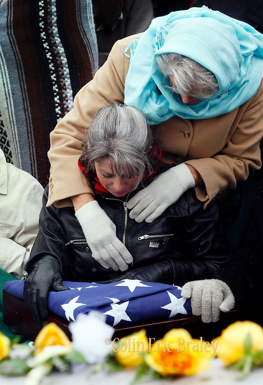Teena Nemelka, mother of fallen U.S. Army Pfc. Aaron Nemelka, is consoled by an unidentified family member during a burial ceremony at Camp Williams Nov. 14, 2009 in Riverton, Utah. Nemelka was one of 13 gunned down at Fort Hood, Texas. (AP Photo/Colin Braley)