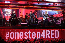 Dec. 1, 2014 - New York, New York, USA - The Edge, Larry Mullen Jr., Bruce Springsteen and Adam Clayton perform as 'U2 - 1' in a surprise concert by (RED) to mark World AIDS Day in Times Square on December 1, 2014 in New York City (Credit Image: © Future-Image/ZUMA Wire)