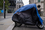 As Storm Ellen hits the capital, a motorbike's cover billows in strong winds as gusts reached the financial district, on 21st August 2020, in London, England.