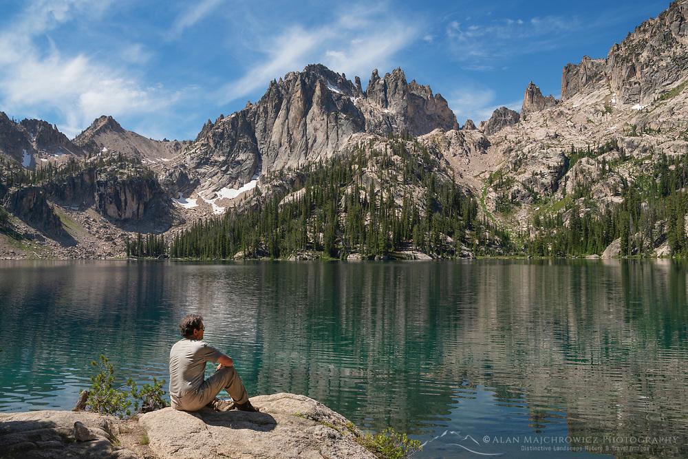 Adult male hiker enjoying the view of Baron Lake and Monte Verita Peak Sawtooth Mountains Idaho