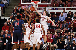 February 3, 2011; Stanford, CA, USA;  Stanford Cardinal forward/center John Gage (40) blocks a shot by Arizona Wildcats forward Derrick Williams (23) during the first half at Maples Pavilion.