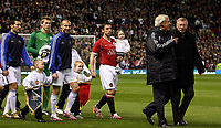 Photo: Paul Thomas.<br /> Manchester United v Europe XI. Friendly match. 13/03/2007.<br /> <br /> Managers Marcello Lippi (2nd R) of Europe and Utd's Sir Alex Ferguson (R) along with the Captians Henrik Larsson and Utd's Gary Neville (Red) lead out the teams.