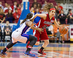 Bridgeport guard Gianina Renzelli (20) tries to get past Fairmont Senior guard Tyaira Horton (3) during a first round game at the Charleston Civic Center.