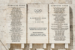Plaques commemorating 1936 Berlin Olympic Games with Jesse Owens name prominent Olympiastadium ( Olympic Stadium) in Berlin, Germany