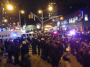 """Dec. 4, 2014 - Manhattan, NY. Police officers block the intersection at 96th Street and Broadway after protestors against the death of Eric Garner stage a """"die-in"""" along Broadway on Thursday, Dec. 4, 2014. 12/4/14 Photograph by Jake Becker/NYCity Photo Wire"""