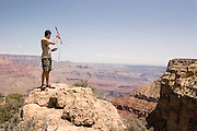 Northern Arizona University wildlife technician Eddie Perry uses a receiver to pick up a radio signal from a Allen's big-eared bat (Idionycteris phyllotis) that he placed a transmitter on the night before. He wants to find the day-roosting location (usually well hideen during the day) of the bat to better understand how how far they travel while hunting at night.